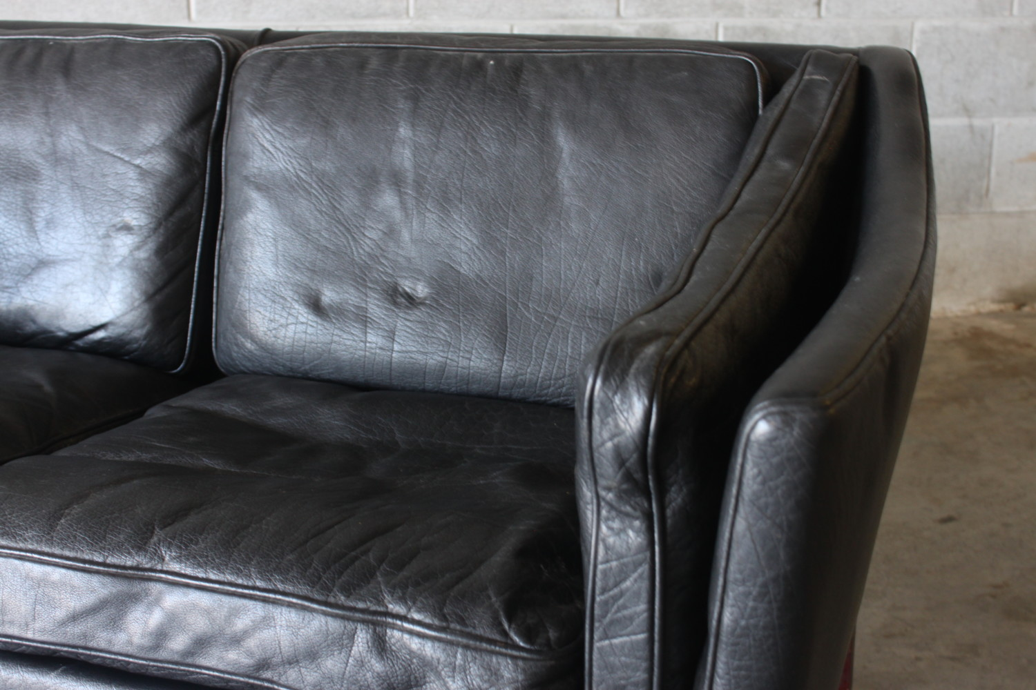 Pair of Black Leather Sofas Sold