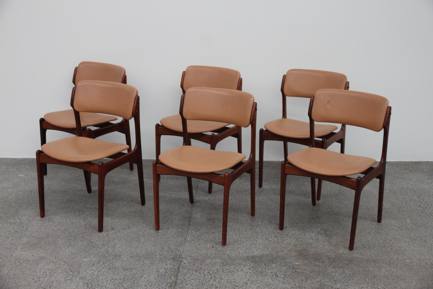 Rosewood and leather Dining Chairs by Erik Buch