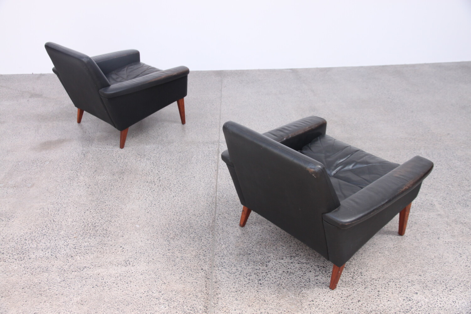 Pair of Black Leather Armchairs